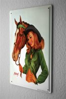 Tin Sign Baron sexy pinup girl with a horses bridle, and...